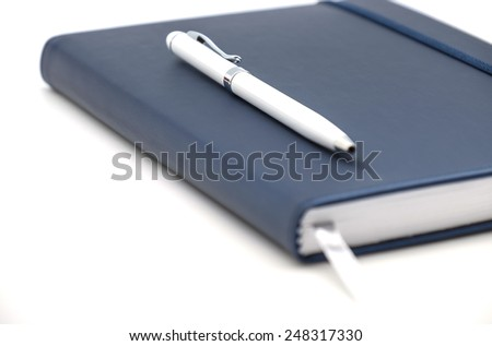 Close up of diary, planner or organizer for business use on white background - stock photo