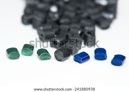 close up of different colored plastic granulates - stock photo
