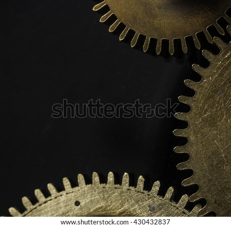 Close up of different connecting watch cogs