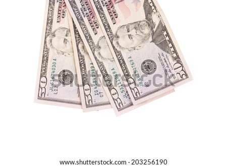 Close up of different dollar bills. Isolated on a white background. - stock photo