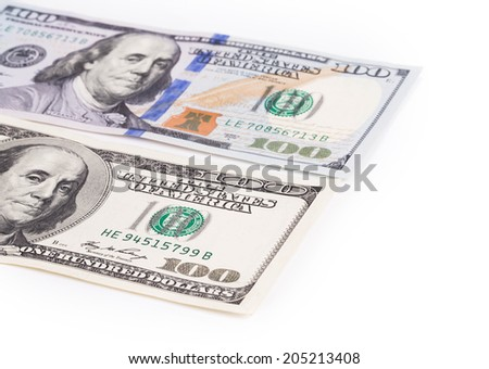 Close up of different dollar bills. Isolated on a white background.