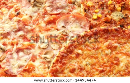 Close-up of different kinds of pizza.