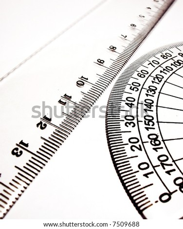 Close up of different rulers and school supplies