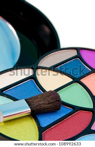 close up of different shades of eyeshadow with brush