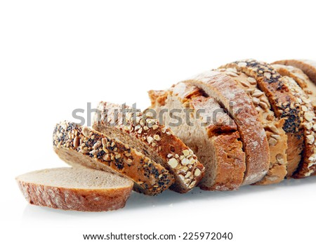 Close up of different sliced fresh bread arranged in a single loaf showing both rye and wheat bread with sunflower, sesame and poppy seed coatings, over white - stock photo