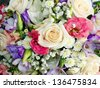 Close-up of different spring flowers with rose in focus - stock photo