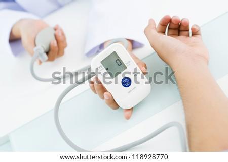 Close-up of digital screen of blood pressure gauge - stock photo