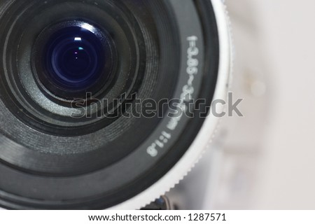 Close up of digital video camera lens - stock photo