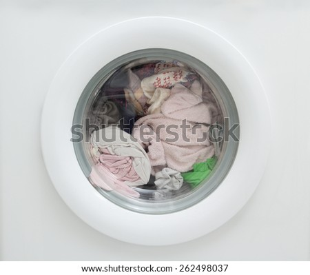 close up of dirty laundry inside of washing machine