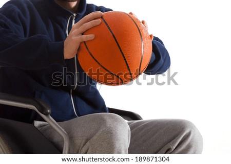 Close-up of disabled man throwing basketball, horizontal - stock photo