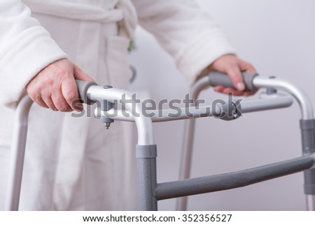 Close up of disabled person with walking zimmer