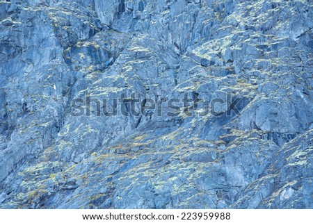 Close up of distant rocky slope covered with lichens in Hibiny mountains above the Arctic Circle, Russia - stock photo