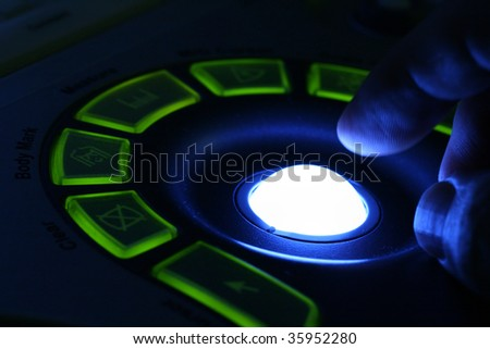 close-up of doctor hand on the control panel of ultrasound machine - stock photo