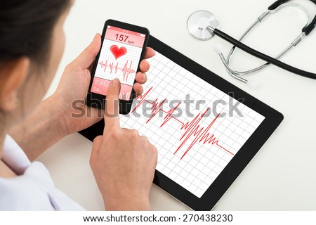 Close-up Of Doctor Holding Mobile Phone With App For Health - stock photo