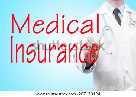 close up of doctor writing word medical insurance on screen glass with marker pen - stock photo