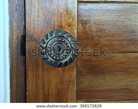 close up of door knob on wooden door