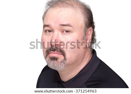 Close up of downcast middle aged male in black shirt with graying beard and mustache over white background