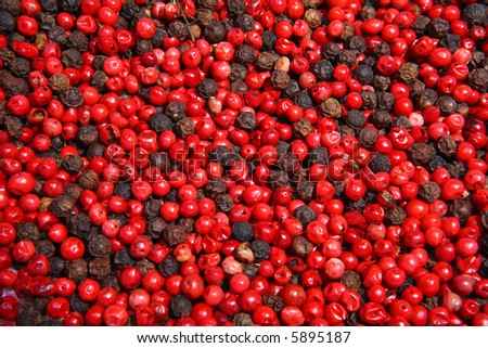 Close-up of dried black and red peppercorns