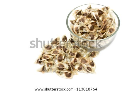 Close up of dried chili in glass blow, food ingredient ,on white background - stock photo