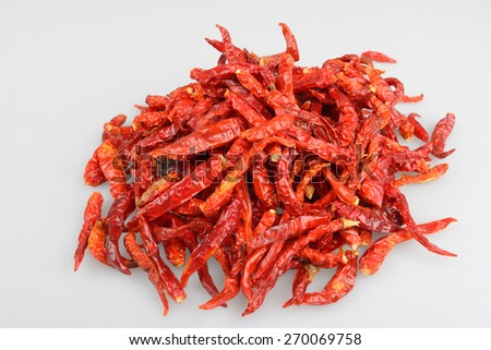 Close up of dried chili in glass bowl, food ingredient. - stock photo