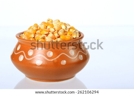 Close Up of Dried corn in clay pot with heap used for making popcorn  - stock photo