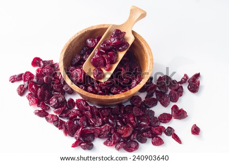 close up of dried cranberry on white background