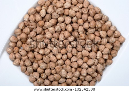 Close up of dried Garbonzo Beans, or Chick Peas - stock photo