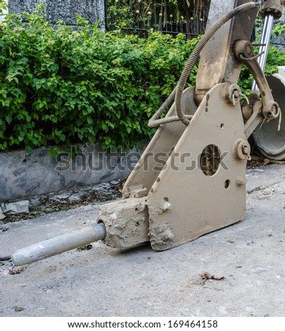 close up of drill concrete tractor - stock photo