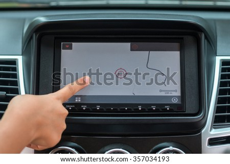Close-up Of Driver Using Gps Navigation System In Car