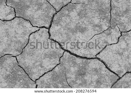 close-up of dry dracked soil ground texture (grayscale) - stock photo