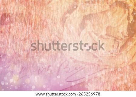 Close up of dry rose and Love word written on card. Soft light and bokeh effect, paper texture for background. - stock photo