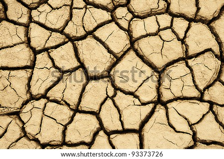 Close-up of earth cracked because of drought - stock photo