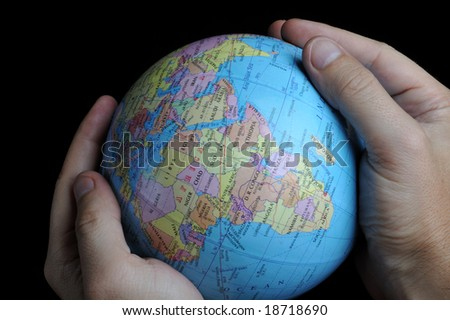 Close-up of Earth globe in hands