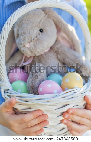 close-up of easter basket with colorful eggs and bunny at spring time  - stock photo