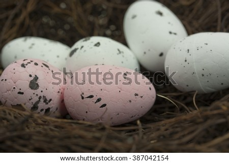 Close up of Easter eggs in a nest.