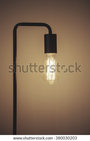 Close up of edison filament light bulb lamp with space for text