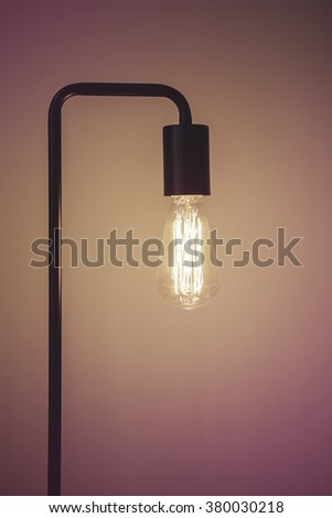 Close up of edison filament vintage table lamp with space for text
