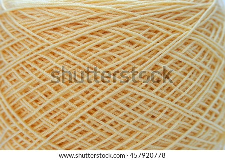 Close up of Eggshell ball of wool yarn and knitting needles. Handcraft equipment used for needlework as a hobby. - stock photo