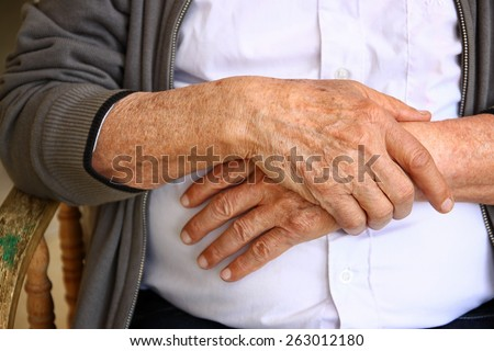 close up of elderly male hands  - stock photo