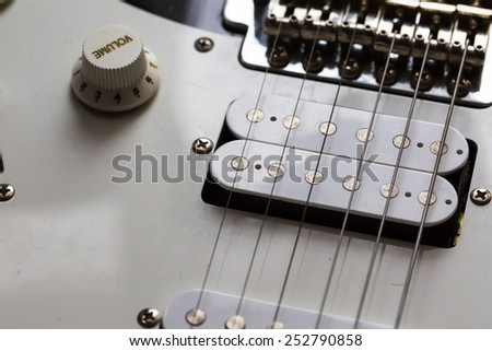 close up of electric guitar element - stock photo