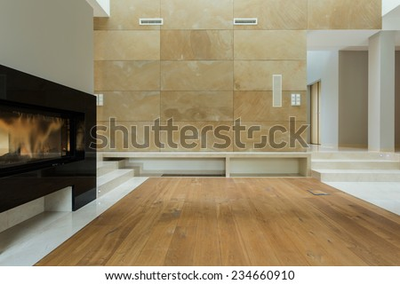 Close-up of electrical fireplace in living room - stock photo