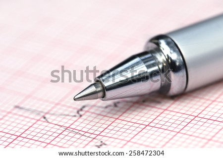Close up of Electrocardiograph with a pen - stock photo