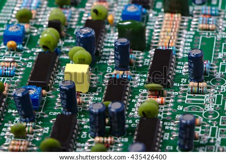 Close-up of electronic circuit board with integrated circuit and components. - stock photo