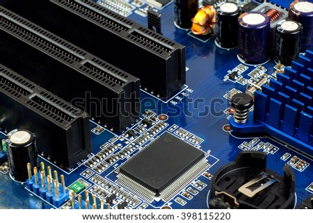 Close-up of electronic circuit board with processor. Small depth of field. - stock photo