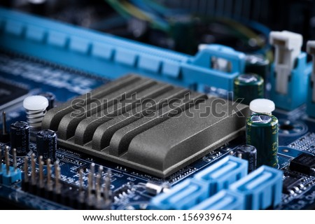 close-up of electronic circuit board with radiator - stock photo