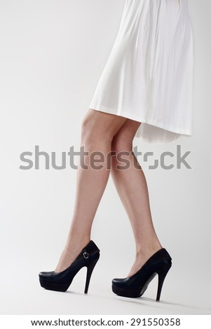 Close up of elegant female legs on white - stock photo