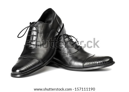 Close-up of elegant men shoes on white background - stock photo