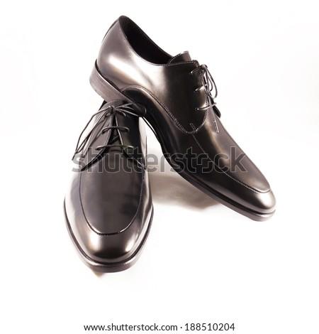 Close up of elegant mens shoes on white background - stock photo