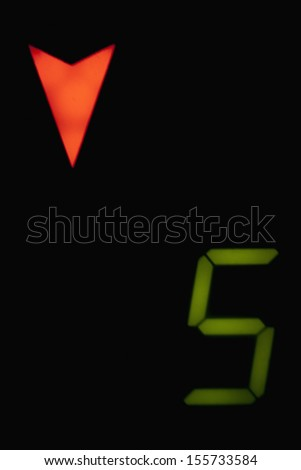 Close-up of elevator floor indicator - stock photo