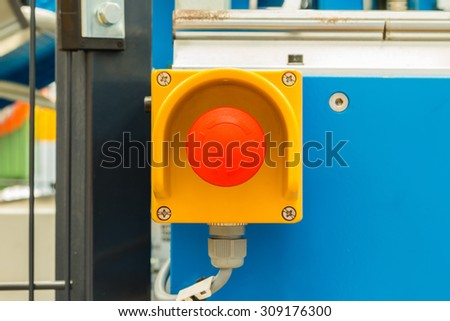 Close up of emergency stop button switch, an electrical device for safety, installed on the machine - stock photo
